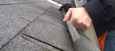 Placing the rain diverter under the shingles.
