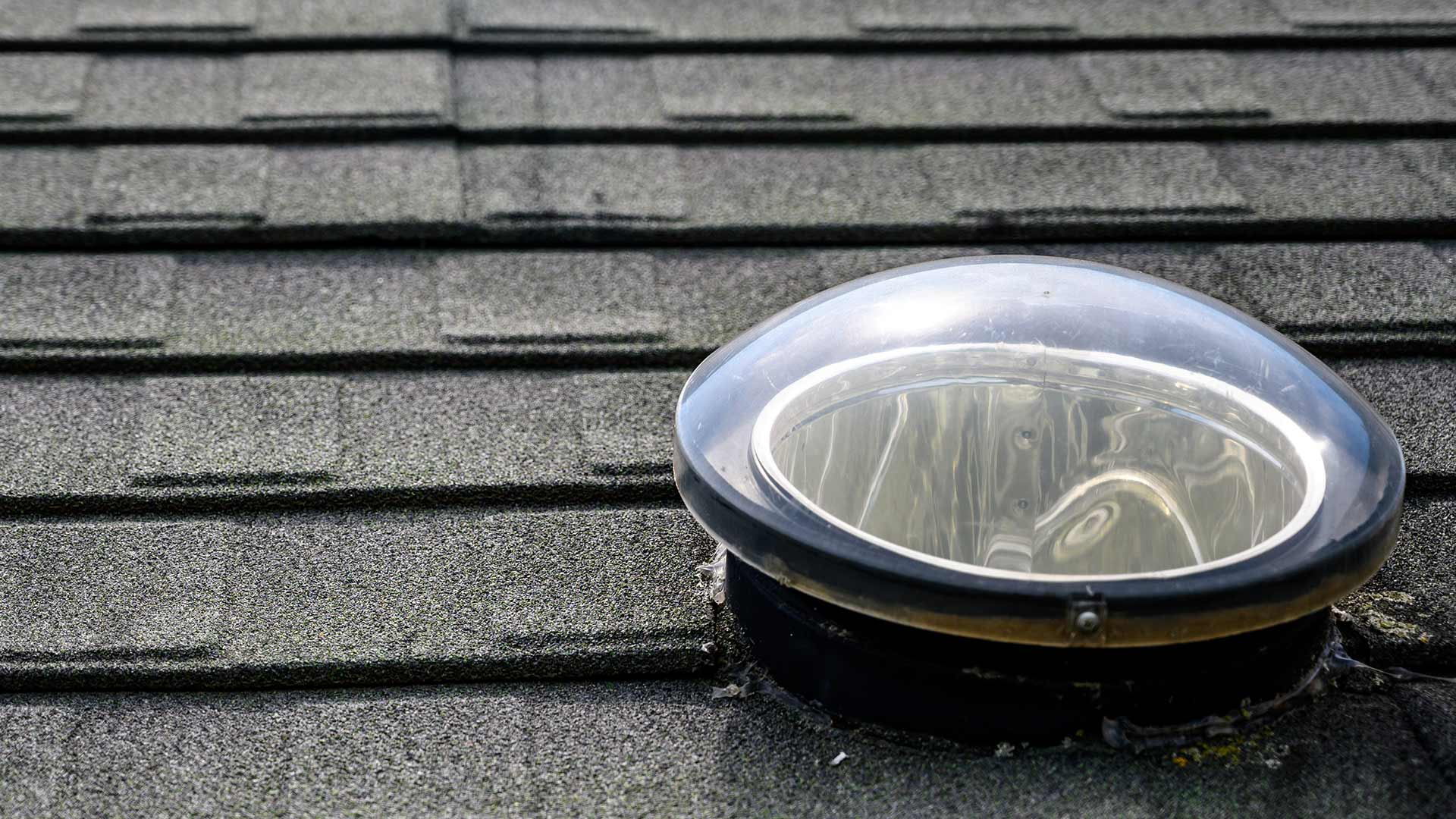 Tubular skylight installed on asphalt shingle roof
