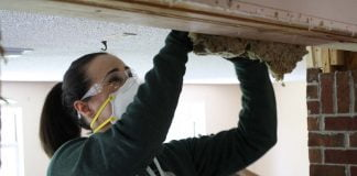 Woman installing insulation