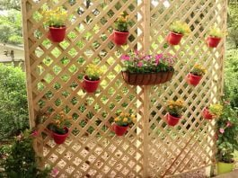 Privacy wall made of lattice and hanging planters