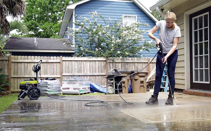 Power washing the concrete
