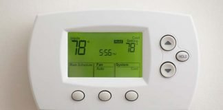 Digital programmable thermostat, seen set to 78 degrees Fahrenheit