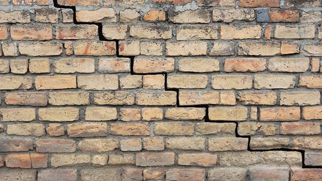 Brick wall with missing mortar