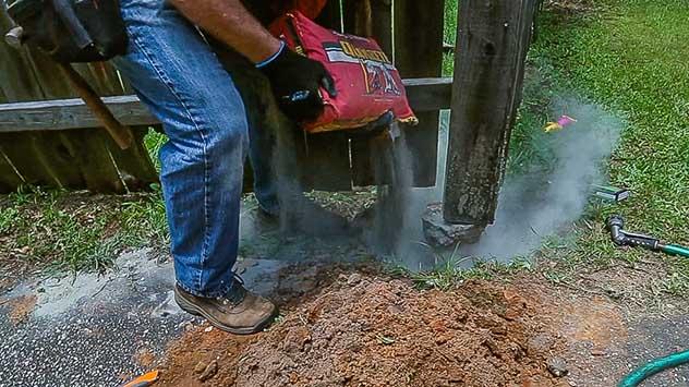 Pouring Quikrete Fast-Setting Concrete Mix