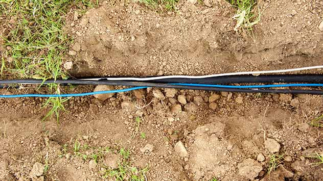 Close up construction trench with electrical wires