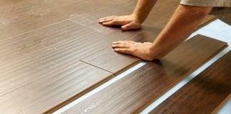 Man installing laminate plank flooring