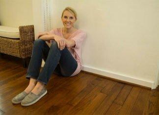 Chelsea Lipford Wolf sitting on hardwood floor