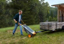 Man using the Worx Aerocart as a wheelbarrow.