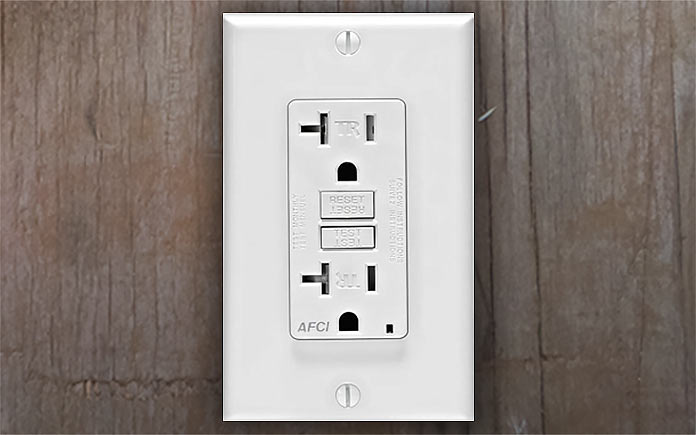 Arc-fault circuit interrupter outlet on a wood-panel wall