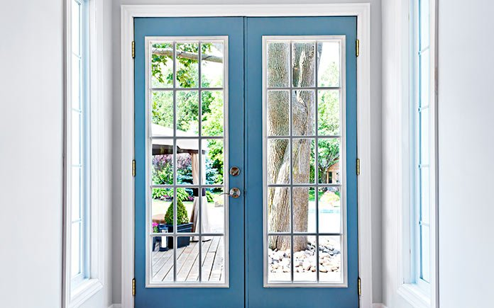 Blue French doors leading to the patio