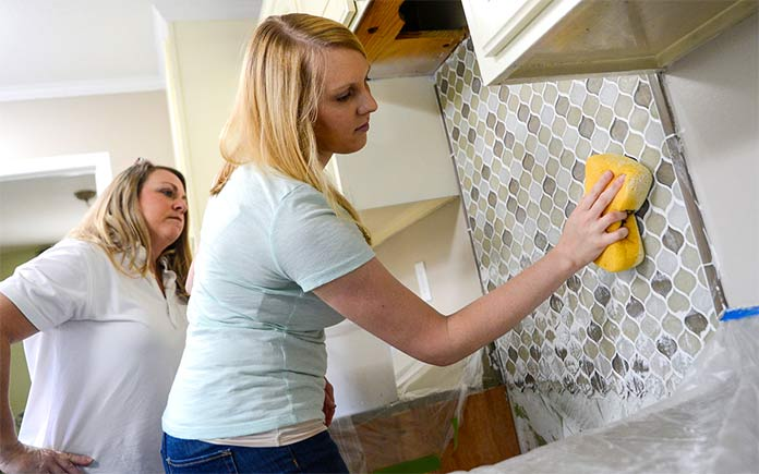 Chelsea Lipford Wolf installing kitchen backsplash