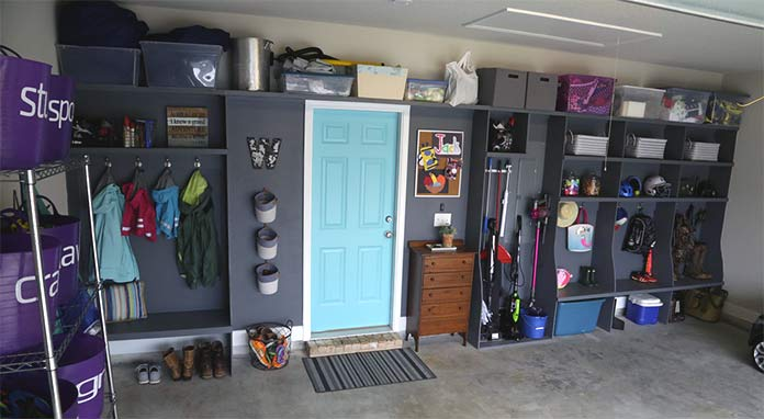 Clean and organized garage with hanging baskets and cubby holes for a family's items