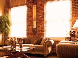 Condo with solar heat streaming through oversized windows.