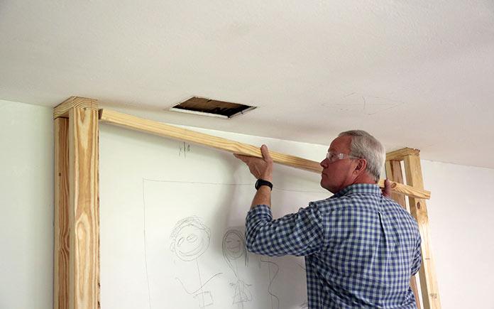 Danny Lipford frames Barbara Crigler's bump-out wall