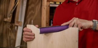 DIY hand sander made of PVC pipe and sandpaper