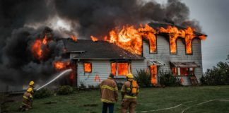 Firefighters putting out a fire that has engulfed a two-story home