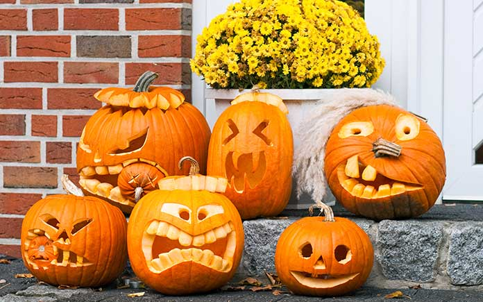 Jack-o-lanterns on a home's front steps during the morning