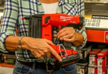 Jodi Marks holds a Milwaukee Brad Nailer in a Home Depot store during a Best New Products taping.