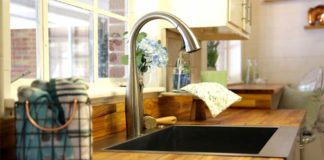 Butcher block countertop with modern kitchen faucet and apron sink