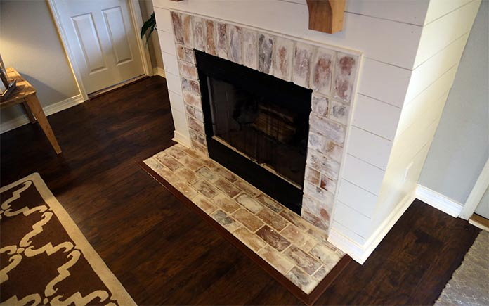 Rustic fireplace with shiplap surround
