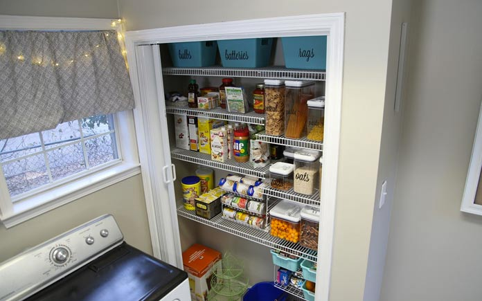Well stocked pantry with canned goods, cereal and other household essentials