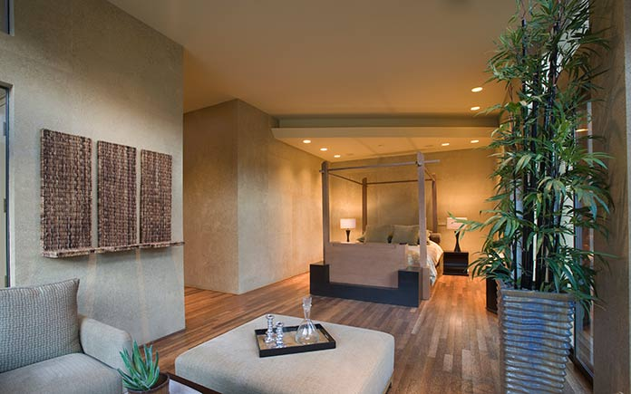 Bedroom with bamboo floors and lucky bamboo plant.