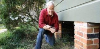 Danny Lipford next to crawlspace under house.