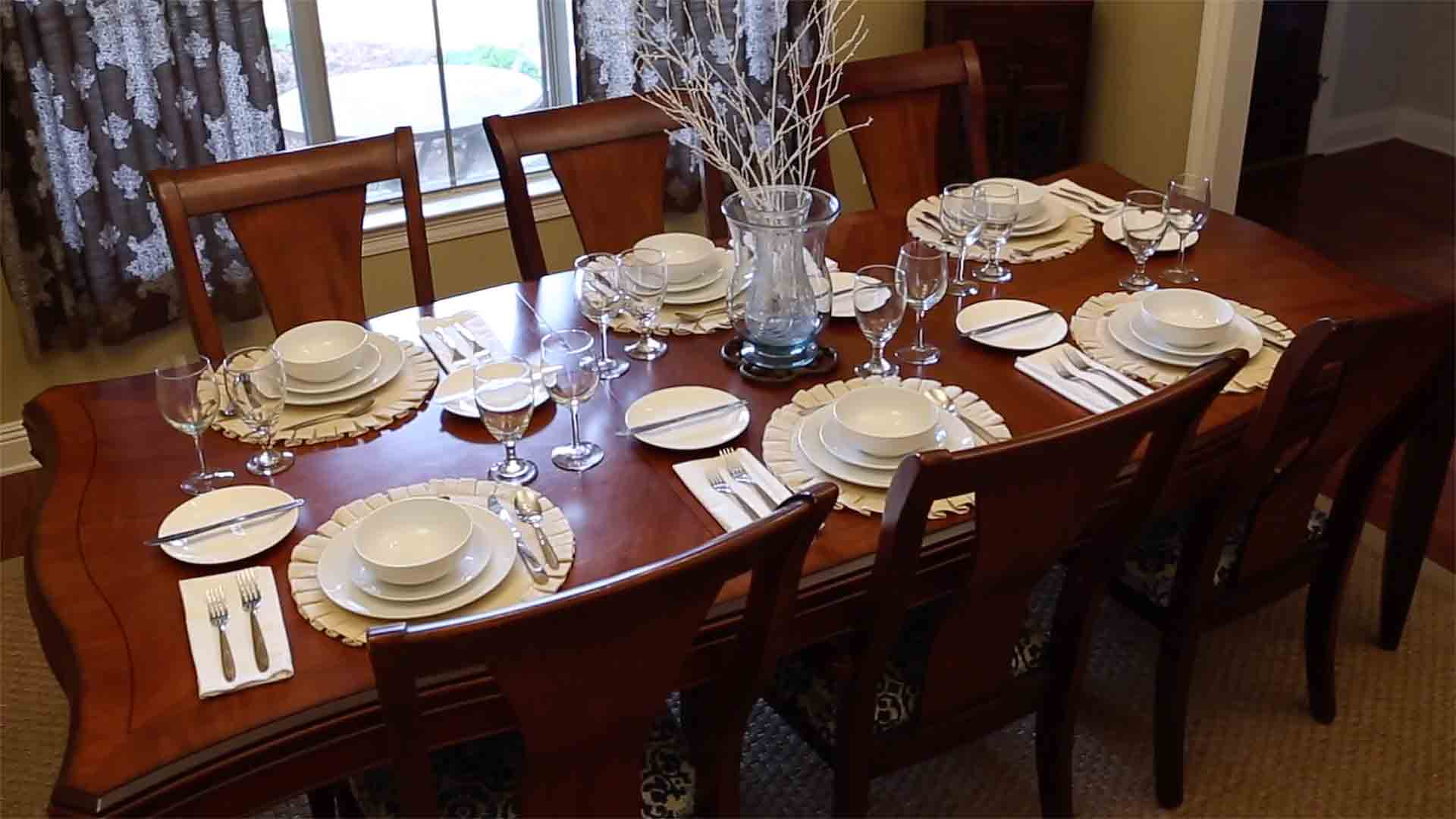 Dinner table with place settings, ready for Thanksgiving