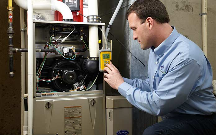 HVAC professional checking air conditioner