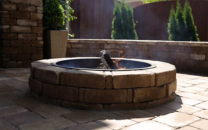 Pavestone fire pit on a paver patio in Tennessee