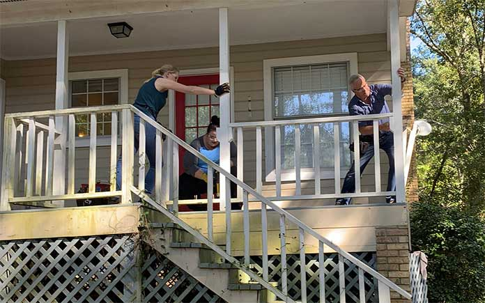 Danny Lipford and Chelsea Lipford Wolf remove handrails on screen porch