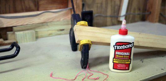 Split wood being clamped in workshop
