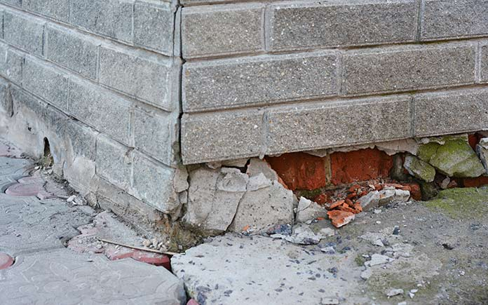 Water-damaged foundation with bricks showing