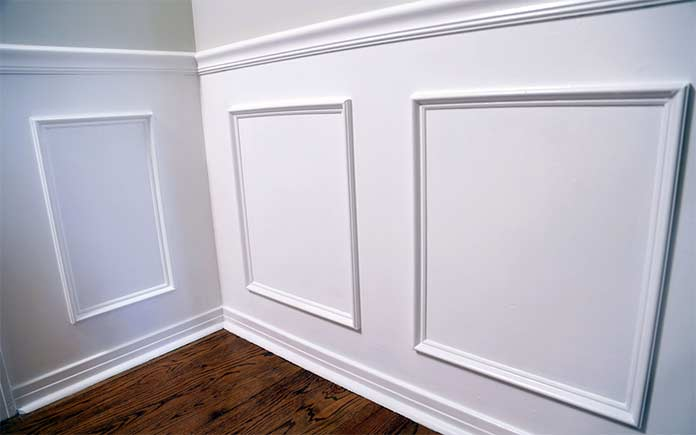 Faux wainscoting and hardwood floor in dining room