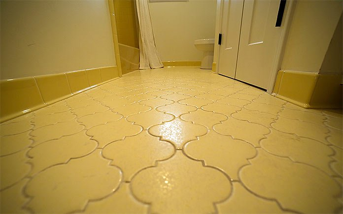 Yellow ceramic tile bathroom floor