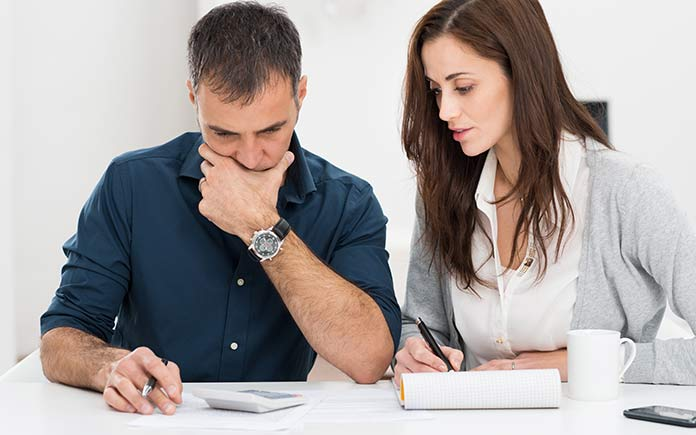 Young couple reviewing budget