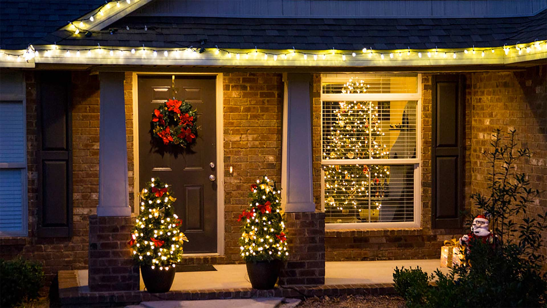 Front porch decked out with Christmas lights at night
