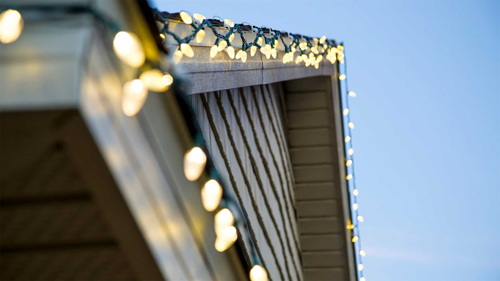 Christmas lights on roof and along home's exterior