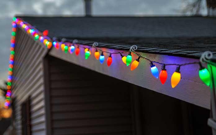 Christmas lights installed in gutter hooks