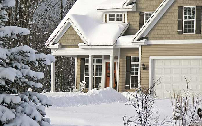 House surrounded by heavy snow