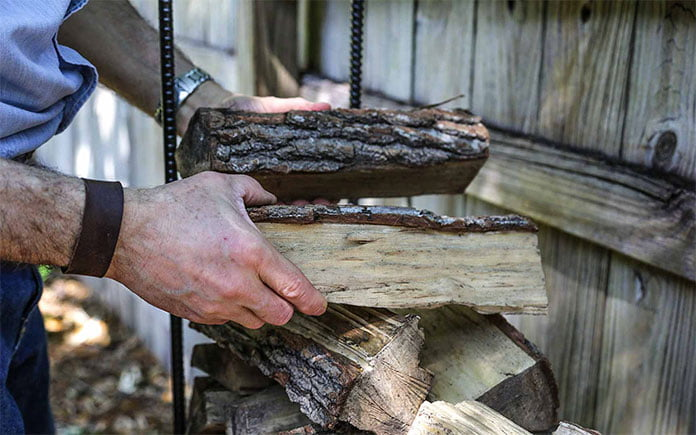 Joe Truini stacks firewood during a taping of Today's Homeowner