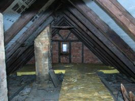 Old attic with soot stains and moisture