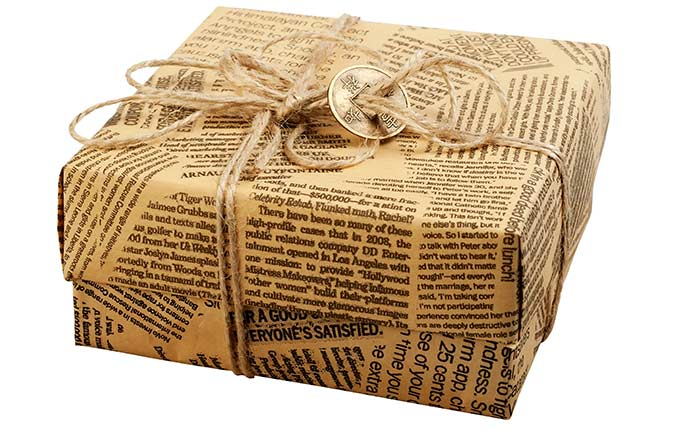 Christmas gift wrapped in repurposed newspaper
