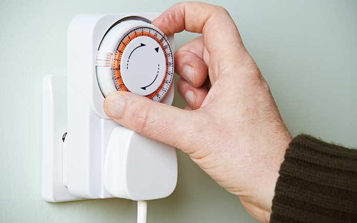Hand adjusting dial for timed electrical outlet