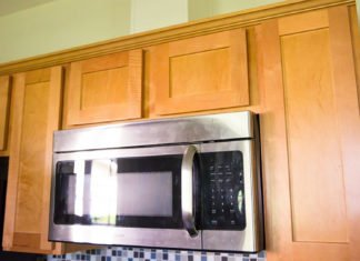 Over the range microwave went vent pipe concealed with cabinet-grade plywood.