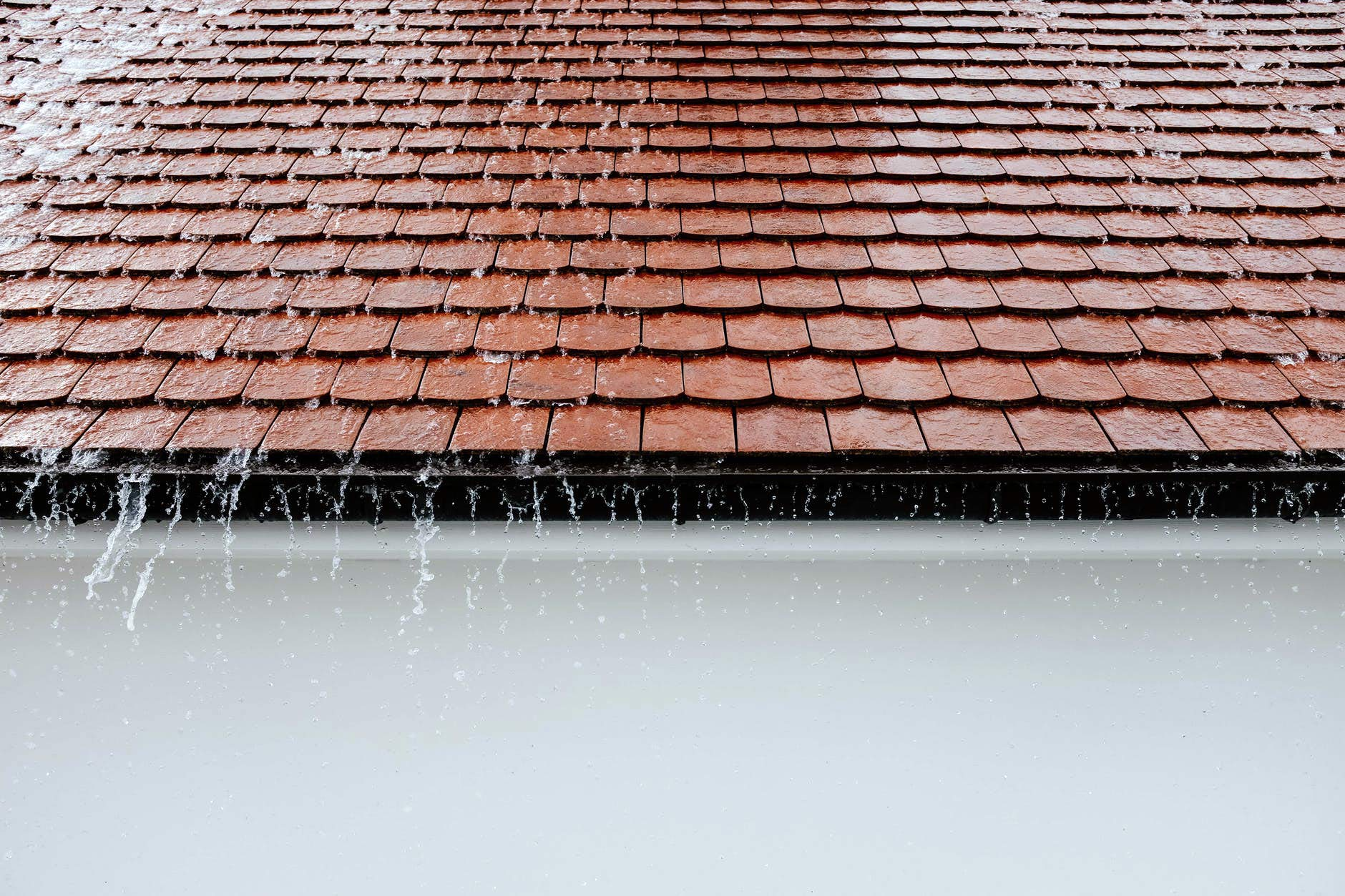 Rain falling from red roof