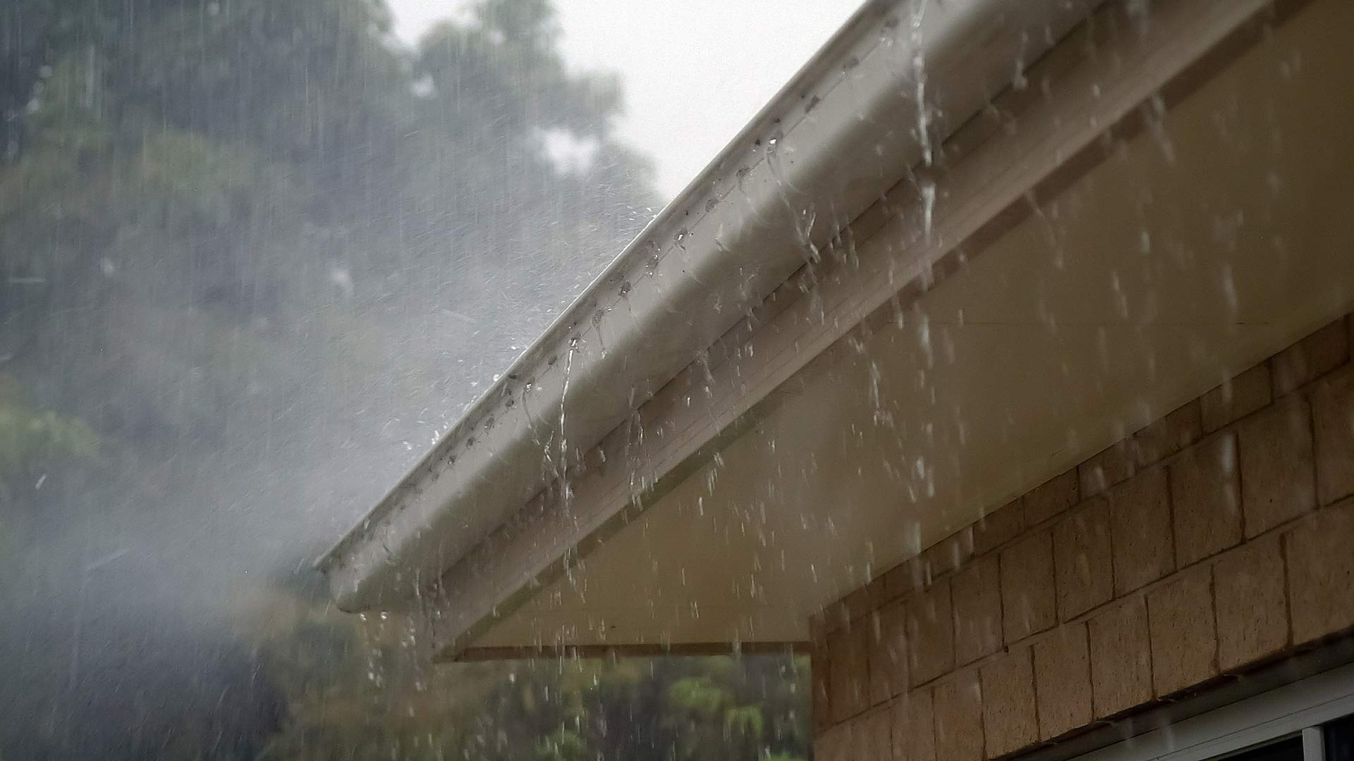 Raindrops falling from roof