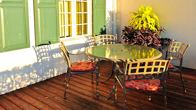 Aluminum furniture on a wood plank patio