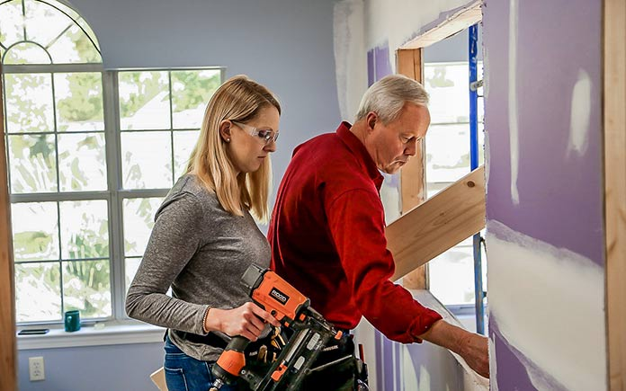 Chelsea Lipford Wolf and Danny Lipford install drywall