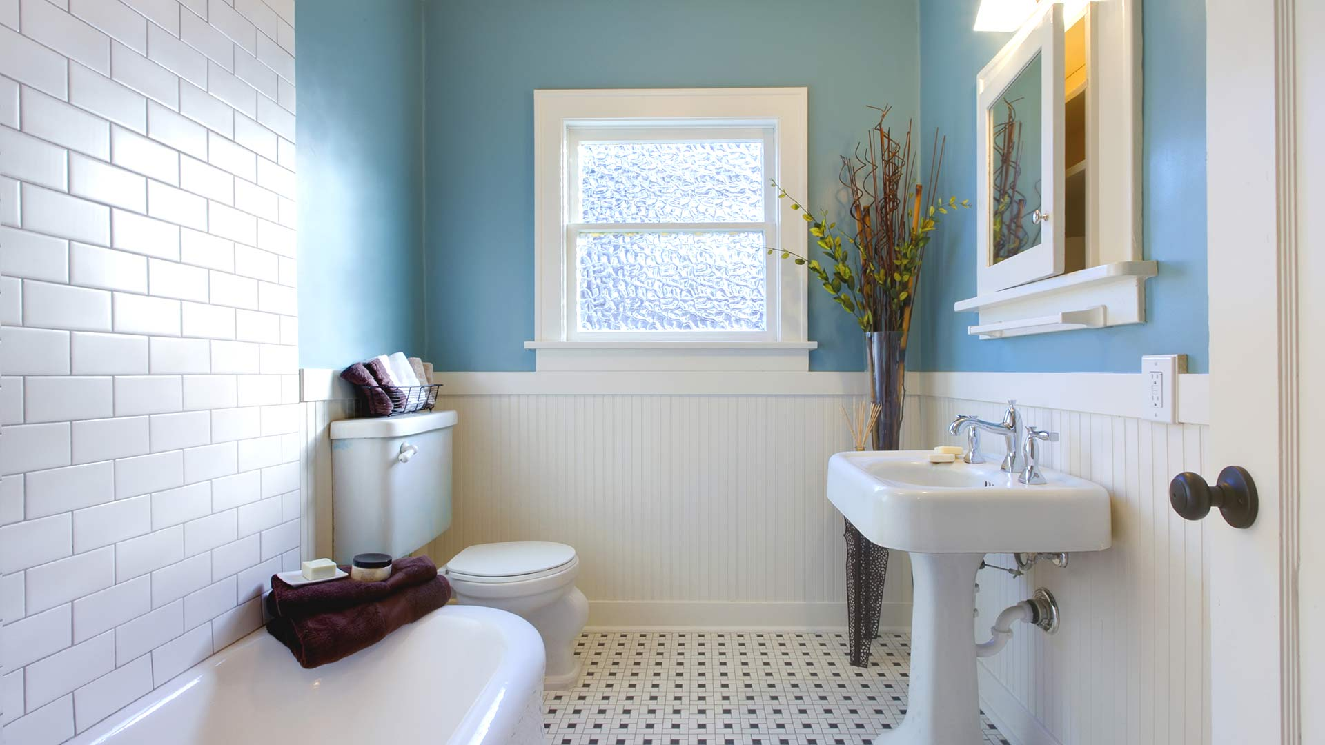 Eco-friendly bathroom with ceramic tile floors and blue walls